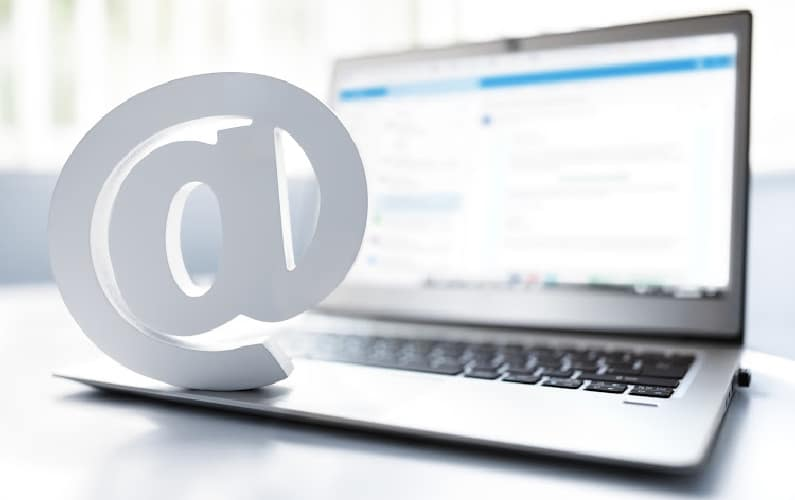 laptop with @ symbol for email marketing