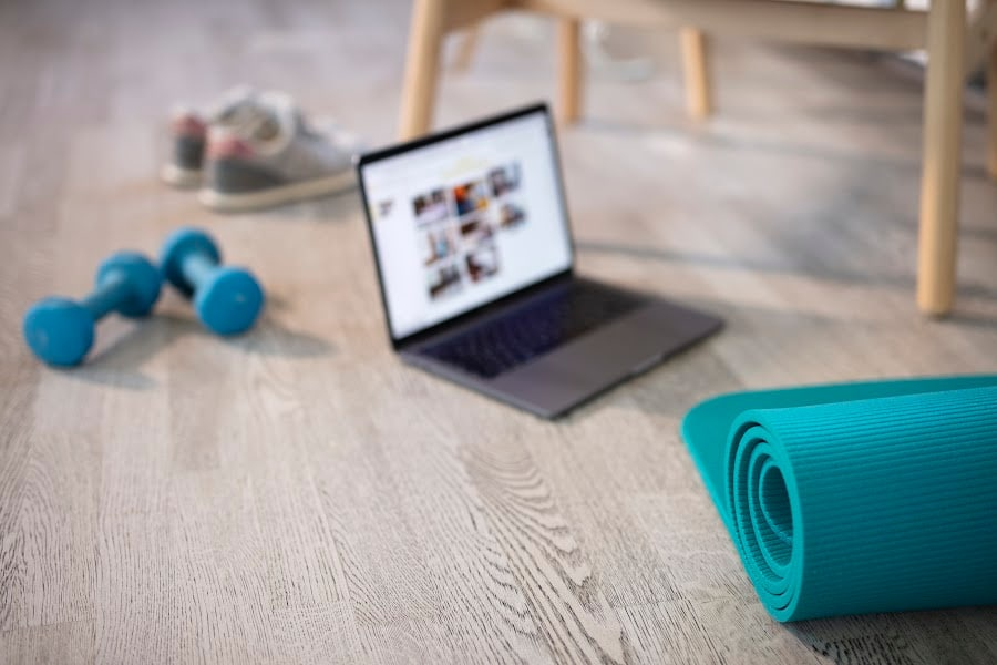 weights and yoga mat with beachbody on demand